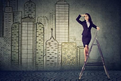 business-woman-on-a-ladder-looking-far-away.jpg